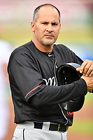 Birmingham Barons manager Omar Vizquel (13) prepares to coach third base during a game against the Tennessee Smokies at Smokies Stadium on May 15, 2019 in Kodak, Tennessee. The Smokies defeated the Barons 7-3. (Tony Farlow/Four Seam Images)
