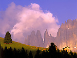 Italy, South Tyrol, Alto Adige, Dolomites, alpine pasture, Torri del Vajolett and Cima Catinaccio mountain range in Alpenglow