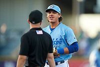Omaha Storm Chasers first baseman Nick Pratto (32) talks to umpire Rich Grassa during a game against the Iowa Cubs on August 14, 2021 at Werner Park in Omaha, Nebraska. Omaha defeated Iowa 6-2. (Zachary Lucy/Four Seam Images)