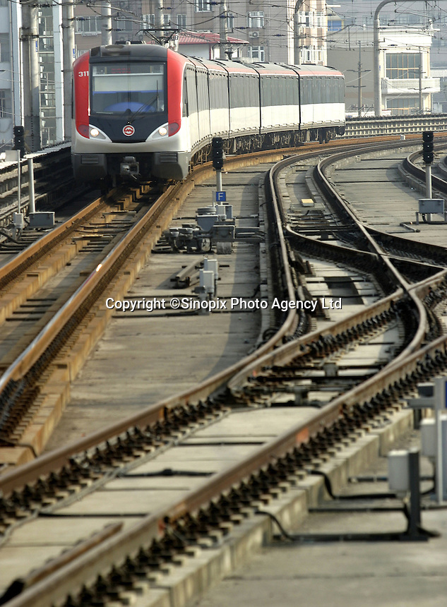 A light rail train cruises on its tracks in Shanghai, China. Shanghai currently has three railed mass transit lines in operation, and five more either under construction or on the drawing board. With the rapid worsening of the city's road traffic due to an increase of motor vehicles, more mass transit lines will be badly needed to ease the jam..21-OCT-03