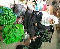 "A Palestinian Woman  selling  vegetables , search for customers after the economic blockade imposed on them after the victory of Hamas in the legislative elections last year <br /> May.20.2007""photo by Fady Adwan"""