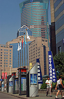 A man passes a sign for Metrobank. The Pudong area is the newly developed commercial district of Shanghai it is home to many banks and financial institutions..