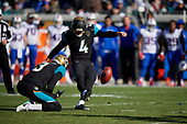 Jacksonville Jaguars Josh Lambo (4) kicks a 44 yard field goal with two seconds left in the second quarter during an NFL Wild-Card football game against the Buffalo Bills, Sunday, January 7, 2018, in Jacksonville, Fla.  Brad Nortman (3) holds.  (Mike Janes Photography)