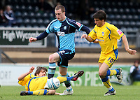 Scott Davies of Wycombe Wanderers eludes a tackle and tries to outpace Colchester's Kemal Izzet during Wycombe Wanderers vs Colchester United, Coca Cola League Division One Football at Adams Park on 17th October 2009