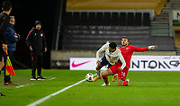 13th October 2020; Molineux Stadium, Wolverhampton, West Midlands, England; UEFA Under 21 European Championship Qualifiers, Group Three, England Under 21 versus Turkey Under 21; Ogulcan Ulgun of Turkey slide tackles James Justin of England along the side line