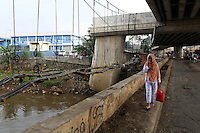 A woman walks along a bridge in central Jakarta.<br /> <br /> To license this image, please contact the National Geographic Creative Collection:<br /> <br /> Image ID: 1588056 <br />  <br /> Email: natgeocreative@ngs.org<br /> <br /> Telephone: 202 857 7537 / Toll Free 800 434 2244<br /> <br /> National Geographic Creative<br /> 1145 17th St NW, Washington DC 20036