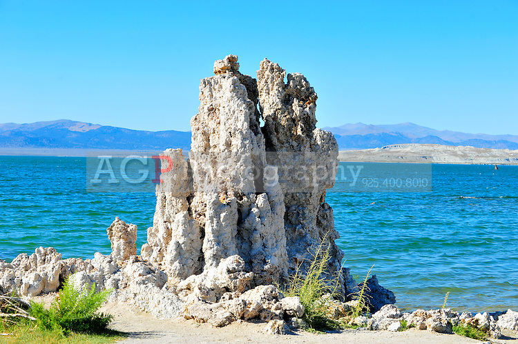 """Sept. 5, 2010 - Mono Lake, California, U.S. - Tufa towers are seen along the shore of Mono Lake near Lee Vining, California with the towering Sierra Mountain range in the background.  """"tufa towers,"""" are calcium-carbonate spires and knobs formed by interaction of freshwater springs and alkaline lake water. Mono Lake is a majestic body of water covering about 70 square miles. It is an ancient lake, over 1 million years old -- one of the oldest lakes in North America. It has no outlet and no fish; instead it is home to trillions of brine shrimp and alkali flies. (Photo by Alan Greth/ZUMA Press)"""