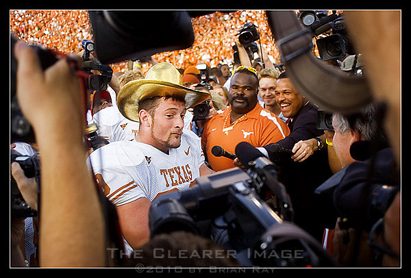 Texas defensive end Brian Robison mugs for the media cameras while wearing the Golden Hat Trophy after the Longhorns 28-10 victory over the University of Oklahoma Sooners at the Cotton Bowl in Dallas, TX on October 7, 2006. (Brian Ray for Icon Sports Media)