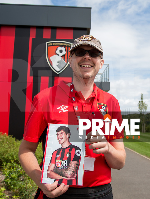 A Programme seller poses with the day's edition during the Friendly match between Bournemouth and Valencia  at the Goldsands Stadium, Bournemouth, England on 30 July 2017. Photo by Andy Rowland.