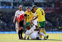 Pictured: Dwight Tiendalli of Swansea on the ground after being brought down by Robert Snodgrass (C) of Norwich while Bradley Johnson (R) is asking him to get up and match referee M Oliver (L) is checking on him. Saturday 06 April 2013<br /> Re: Barclay's Premier League, Norwich City FC v Swansea City FC at the Carrow Road Stadium, Norwich, England.