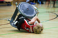 15 AUG 2011 - LEEDS, GBR - Canada's Garett Hickling overturns during the wheelchair rugby exhibition match against Great Britain (PHOTO (C) NIGEL FARROW)