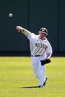 Adam Robinson #4 of the Michigan Wolverines during the Big East-Big Ten Challenge vs. the St. John's Red Storm at Al Lang Field in St. Petersburg, Florida;  February 19, 2011.  St. John's defeated Michigan 13-6.  Photo By Mike Janes/Four Seam Images