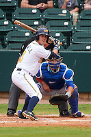 Montgomery Biscuits outfielder Boog Powell (3) at bat in front of catcher Kyle Schwarber and umpire Alex Ransom during a game against the Tennessee Smokies on May 25, 2015 at Riverwalk Stadium in Montgomery, Alabama.  Tennessee defeated Montgomery 6-3 as the game was called after eight innings due to rain.  (Mike Janes/Four Seam Images)
