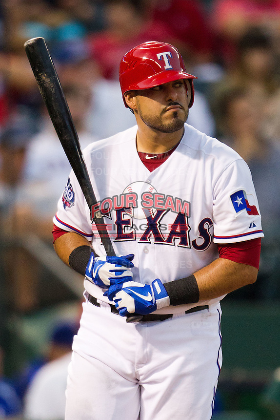 Texas Rangers catcher Geovany Soto #8 at bat during the Major League Baseball game against the Baltimore Orioles on August 21st, 2012 at the Rangers Ballpark in Arlington, Texas. The Orioles defeated the Rangers 5-3. (Andrew Woolley/Four Seam Images).