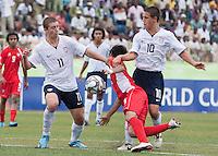 Nick Palodichuk and Luis Gil battle for the ball. US Under-17 Men's National Team defeated United Arab Emirates 1-0 at Gateway International  Stadium in Ijebu-Ode, Nigeria on November 1, 2009.