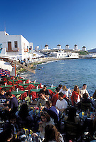 outdoor café, Mykonos, Greek Islands, Cyclades, Greece, Europe, Outdoor café at Little Venice along the waterfront of Mykonos on the Aegean Sea.