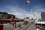 The funeral procession for former Nevada Assembly Speaker Joe Dini moves through downtown Yerington, Nev., on Tuesday, April 15, 2014, past the family-owned Dini Lucky Club Casino. (Las Vegas Review-Journal/Cathleen Allison)