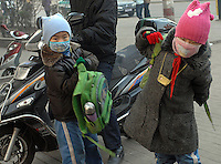 Children make their way to school wearing protective masks in Linfen, Shanxi Province, China. Linfen is reportedly the most polluted city in China and at the heart of the coal mining industry. China produces around 2.4 billion tones of coal annually that contributes to more than 400,000 premature deaths annually due to air pollution, acid rain and poisonous ground water. It also contributes to global warming....PHOTO BY SINOPIX....