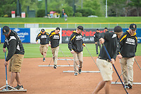 The grounds crew on the field as the Tacoma Rainiers played the Salt Lake Bees in Pacific Coast League action at Smith's Ballpark on May 7, 2015 in Salt Lake City, Utah.  (Stephen Smith/Four Seam Images)