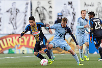 Roger Torres (10) of the Philadelphia Union battles for the ball with Oriol Rosell (20) of Sporting Kansas City. Sporting Kansas City defeated the Philadelphia Union 2-1 during a Major League Soccer (MLS) match at PPL Park in Chester, PA, on October 26, 2013.
