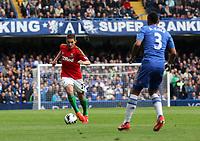 Pictured: Angel Rangel runs at Chelsea defender Ashley Cole <br /> Barclays Premier League, Chelsea FC (blue) V Swansea City,<br /> 28/04/13