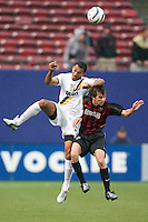 Tyrone Marshall of the Galaxy and Mike Magee of the MetroStars go for a header. The LA Galaxy lost to the NY/NJ MetroStars 1-0 on 6/21/03 at Giant's Stadium, NJ..