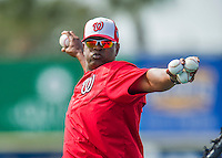 5 March 2016: Washington Nationals Bullpen Catcher Nilson Robledo tosses batting practice prior to a Spring Training pre-season game against the Detroit Tigers at Space Coast Stadium in Viera, Florida. The Nationals defeated the Tigers 8-4 in Grapefruit League play. Mandatory Credit: Ed Wolfstein Photo *** RAW (NEF) Image File Available ***
