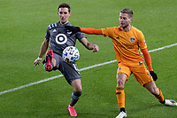 ST PAUL, MN - OCTOBER 18: Ethan Finlay #13 of Minnesota United FC and Mauro Manotas #9 of Houston Dynamo battle for the ball during a game between Houston Dynamo and Minnesota United FC at Allianz Field on October 18, 2020 in St Paul, Minnesota.