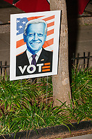 "A sign reading ""Vote"" with a picture of Democratic presidential candidate Joe Biden stands in the ground as demonstrators gather in Black Lives Matter Plaza near the White House on the night of Election Day in Washington, D.C., on Tue., Nov. 3, 2020. Election results remained uncertain late into the night and demonstrators were peaceful."