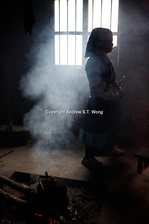 A woman of the ethnic Bouyei Tribe is seen at home at Wangmo County in China's southwestern Guizhou Province, April 2019.
