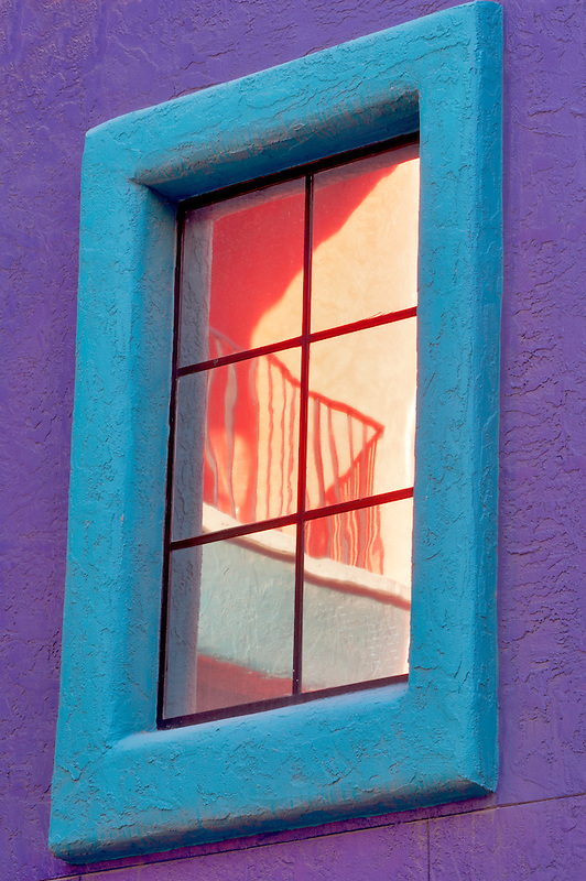 Colorful reflection in windows in La Placita Village. Tucson. Arizona