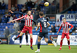 Ross County v St Johnstone…31.07.21  Global Energy Stadium<br />Murray Davidson wins this header against Doninic Samuel<br />Picture by Graeme Hart.<br />Copyright Perthshire Picture Agency<br />Tel: 01738 623350  Mobile: 07990 594431