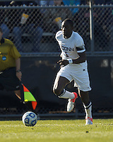 University of Connecticut forward Stephane Diop (5) on the attack. .NCAA Tournament. University of Connecticut (white) defeated Northeastern University (black), 1-0, at Morrone Stadium at University of Connecticut on November 18, 2012.