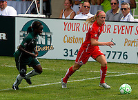 Washington Freedom defender Becky Sauerbrunn (22) and St. Louis Athletica forward Enoila Aluko (9) during a WPS match at Anheuser-Busch Soccer Park, in Fenton, MO, June 20 2009. Washington  won the match 1-0.