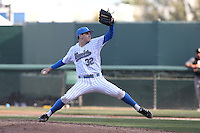 Grant Dyer #32 of the UCLA Bruins pitches against the Cal Poly Mustangs at Jackie Robinson Stadium on February 22, 2014 in Los Angeles, California. Cal Poly defeated UCLA, 8-0. (Larry Goren/Four Seam Images)