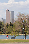 African American walking at City Park, Denver, Colorado .  John offers private photo tours in Denver, Boulder and throughout Colorado. Year-round Colorado photo tours.