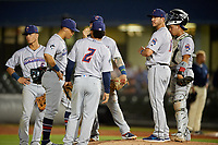 Jacksonville Jumbo Shrimp manager Kevin Randel (11) makes a pitching change as infielders (clockwise) Justin Twine (2), Joe Dunand (3), Bryson Brigman (6), John Silviano (22), and Rodrigo Vigil (1) look on during a Southern League game against the Mobile BayBears on May 7, 2019 at Hank Aaron Stadium in Mobile, Alabama.  Mobile defeated Jacksonville 2-0.  (Mike Janes/Four Seam Images)