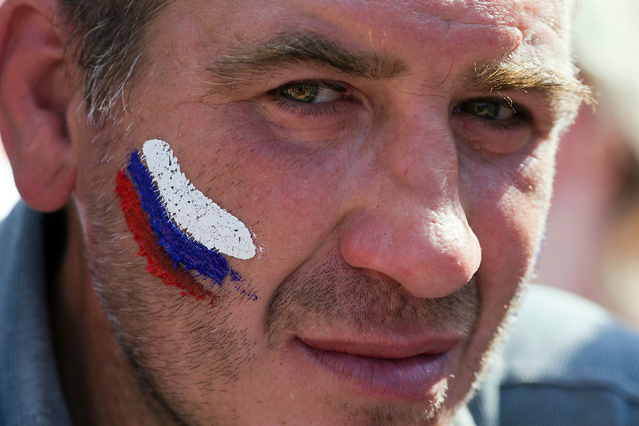 Moscow, Russia, 12/06/2010..A homeless man with a Russian flag painted on his face at a rally of the pro-Kremlin youth group Young Russia during events to mark the Russia Day national holiday.