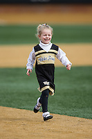 A young Wake Forest Demon Deacons fan runs the bases following the ACC baseball game against the Miami Hurricanes at Wake Forest Baseball Park on March 22, 2015 in Winston-Salem, North Carolina.  The Demon Deacons defeated the Hurricanes 10-4.  (Brian Westerholt/Four Seam Images)