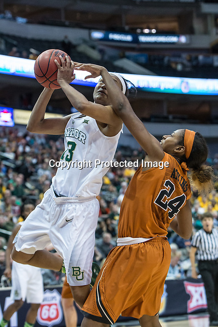 forward Nina Davis (13) drives past guard Ariel Atkins (24) during Big 12 women's basketball championship final, Sunday, March 08, 2015 in Dallas, Tex. (Dan Wozniak/TFV Media via AP Images)