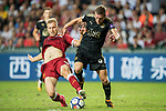 Leicester City FC forward Jamie Vardy (R) fights for the ball with Liverpool FC defender Ragnar Klavan (L) during the Premier League Asia Trophy match between Liverpool FC and Leicester City FC at Hong Kong Stadium on 22 July 2017, in Hong Kong, China. Photo by Weixiang Lim / Power Sport Images