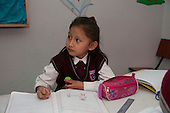 Arequipa, Peru. Hefziba, a parochial (Christian), private school for elementary and secondary school students. Student (girl, elementary-school age, Peruvian) works on schoolwork. No MR. ID: AL-peru.