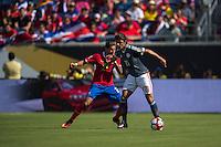 Orlando, Florida - Saturday, June 04, 2016: Paraguayan forward Oscar Romero (21) holds off Costa Rican defender Ronald Matarrita (22) during a Group A Copa America Centenario match between Costa Rica and Paraguay at Camping World Stadium.