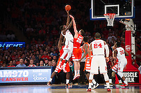 NEW YORK, NY - Sunday December 13, 2015: Kassoum Yakwe (#14) of St. John's, left, has a shot blocked by Tyler Lydon (#20) of Syracuse, right.  St. John's defeats Syracuse 84-72 during the NCAA men's basketball regular season at Madison Square Garden in New York City.