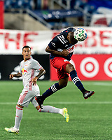 FOXBOROUGH, MA - AUGUST 29: Andrew Farrell #2 of New England Revolution heads the ball during a game between New York Red Bulls and New England Revolution at Gillette Stadium on August 29, 2020 in Foxborough, Massachusetts.