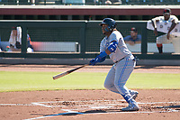 Surprise Saguaros designated hitter Vladimir Guerrero Jr. (27), of the Toronto Blue Jays organization, hits a double during an Arizona Fall League game against the Scottsdale Scorpions at Scottsdale Stadium on October 26, 2018 in Scottsdale, Arizona. Surprise defeated Scottsdale 3-1. (Zachary Lucy/Four Seam Images)