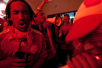 Denmark fans dance and sing to music at a bar just outside the Royal Bafokeng Stadium before the 2010 World Cup first round match between Denmark and Japan in Rustenberg, South Africa on Thursday, June 24, 2010.