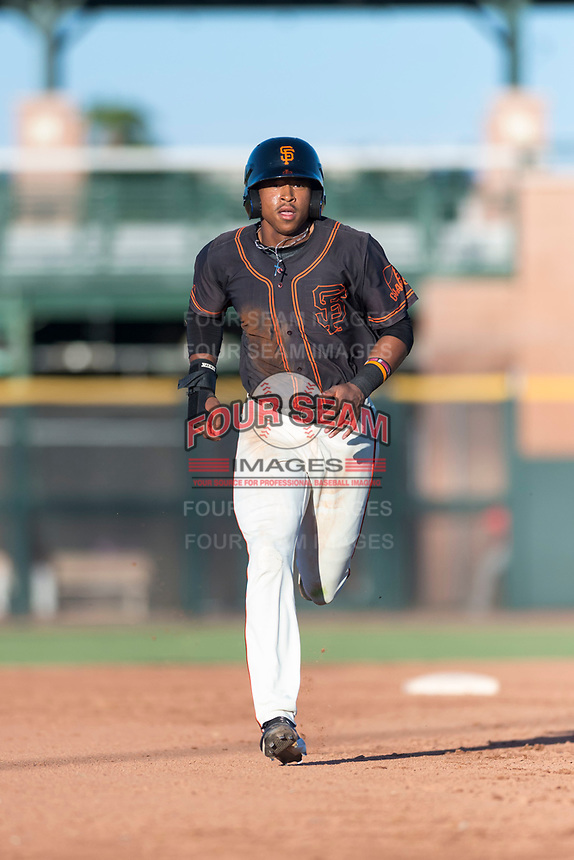 AZL Giants Orange center fielder Randy Norris (1) hustles towards third base during an Arizona League game against the AZL Rangers at Scottsdale Stadium on August 4, 2018 in Scottsdale, Arizona. The AZL Giants Black defeated the AZL Rangers by a score of 3-2 in the first game of a doubleheader. (Zachary Lucy/Four Seam Images)