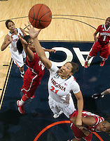 CHARLOTTESVILLE, VA- December 1: Jazmin Pitts #21 of the Virginia Cavaliers reaches for the rebound with Sasha Chaplin #22 and Jasmine McGhee #32 of the Indiana Hoosiers during the game on December 1, 2011 at the John Paul Jones Arena in Charlottesville, Virginia. Virginia defeated Indiana 65-49. (Photo by Andrew Shurtleff/Getty Images) *** Local Caption *** Jasmine McGhee;Sasha Chaplin;Jazmin Pitts