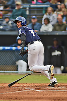 Asheville Tourists second baseman Alec Mehrten #7 runs to first during a game against the  Greenville Drive at McCormick Field on May 17, 2014 in Asheville, North Carolina. The Tourists defeated the Drive 14-6. (Tony Farlow/Four Seam Images)